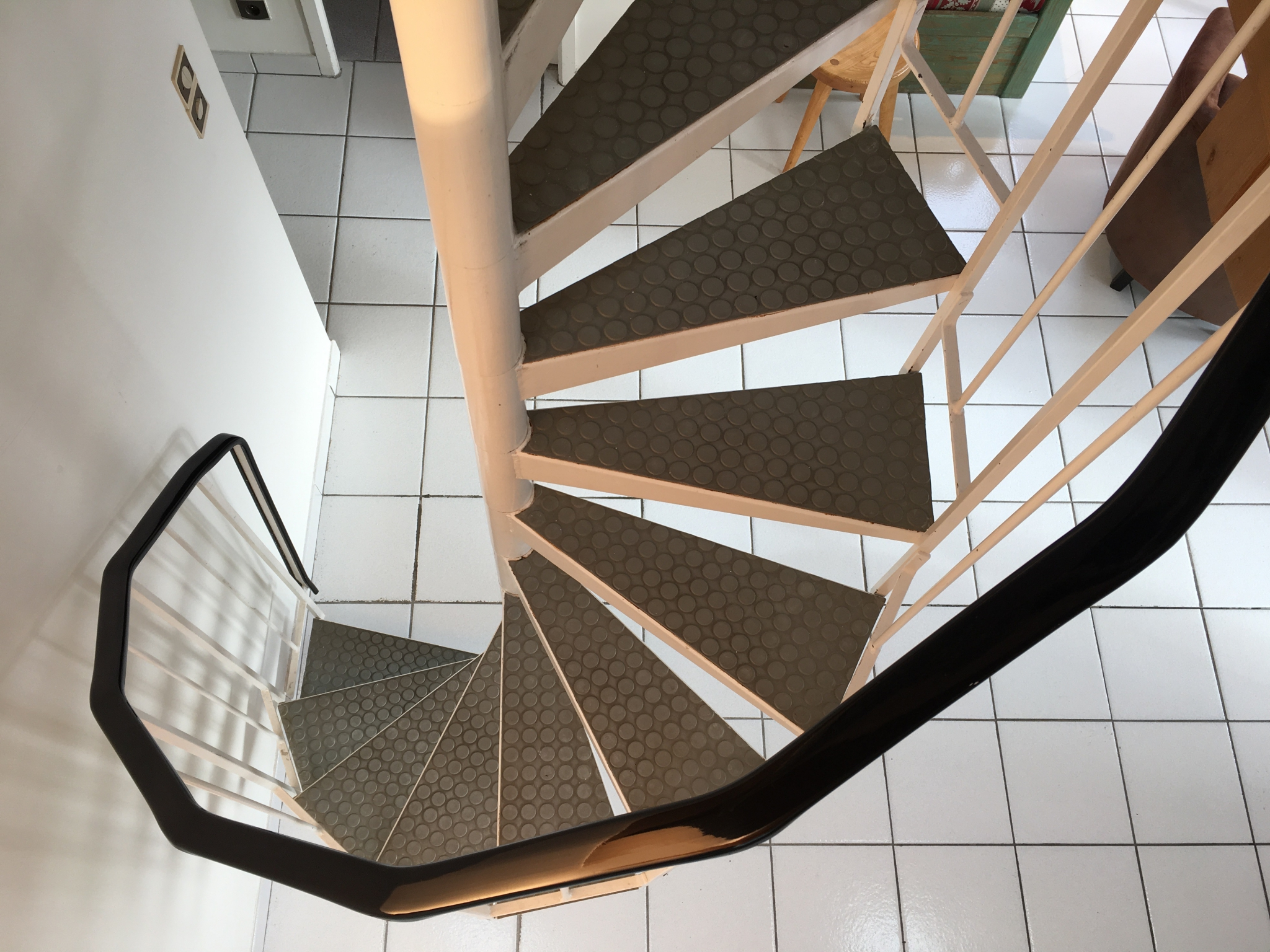 spiral stairs to mezzanine bedroom