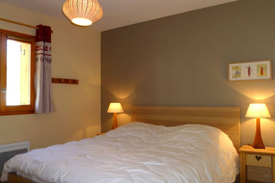 The double bedroom is warm, modern & comfortable