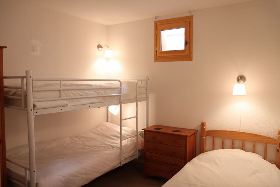 Bedroom 2 has two bunk beds and a single