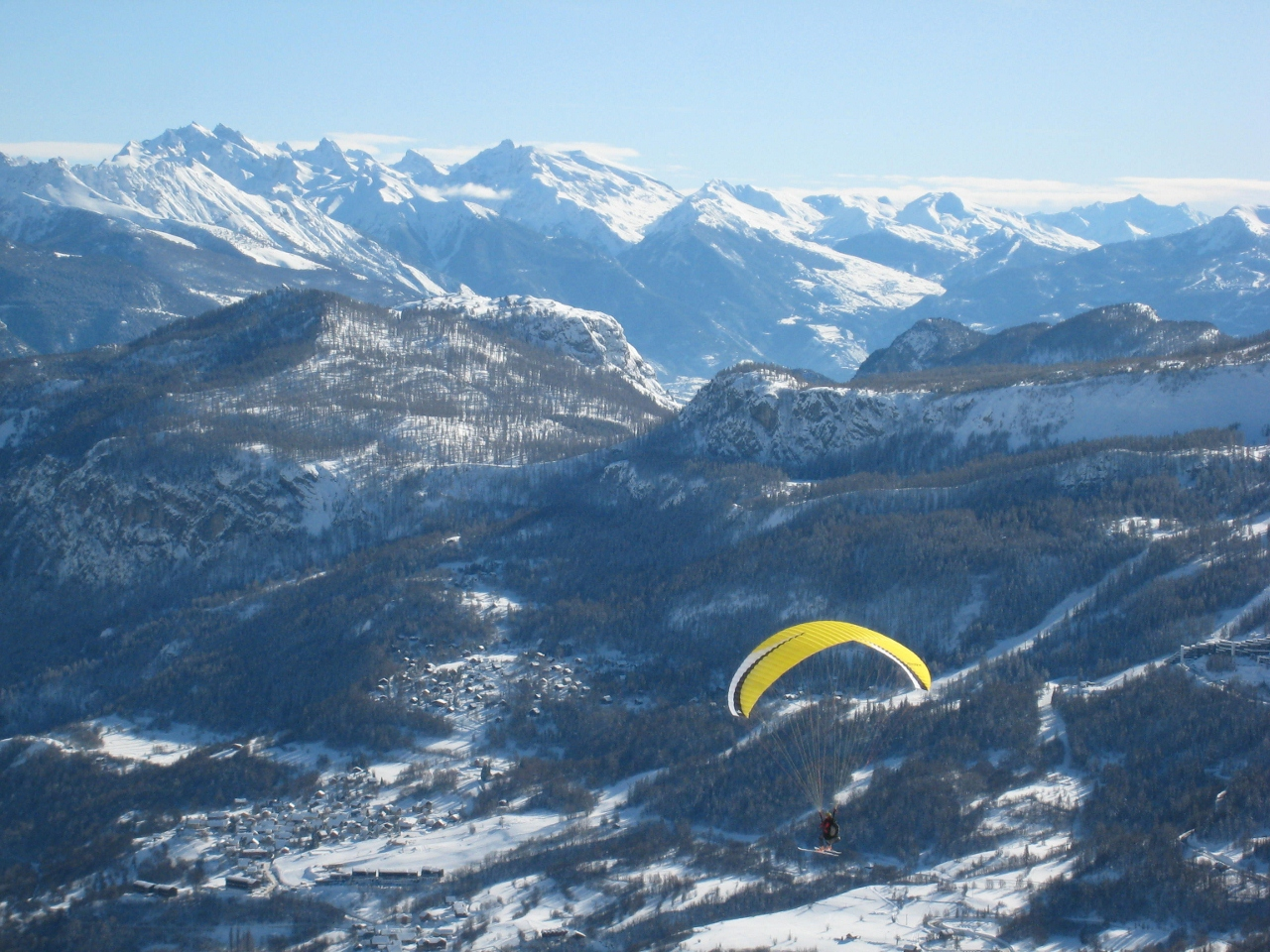 paragliding on skis above puy saint vincent